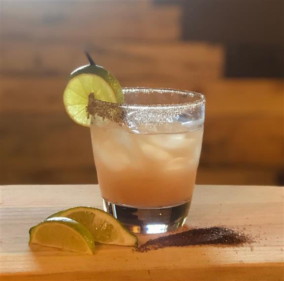 Don Montes in a short glass with a slice of lime