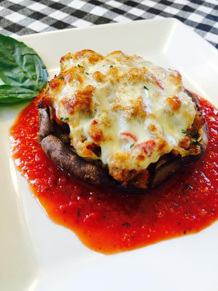 large stuffed mushroom with sauce and cheese