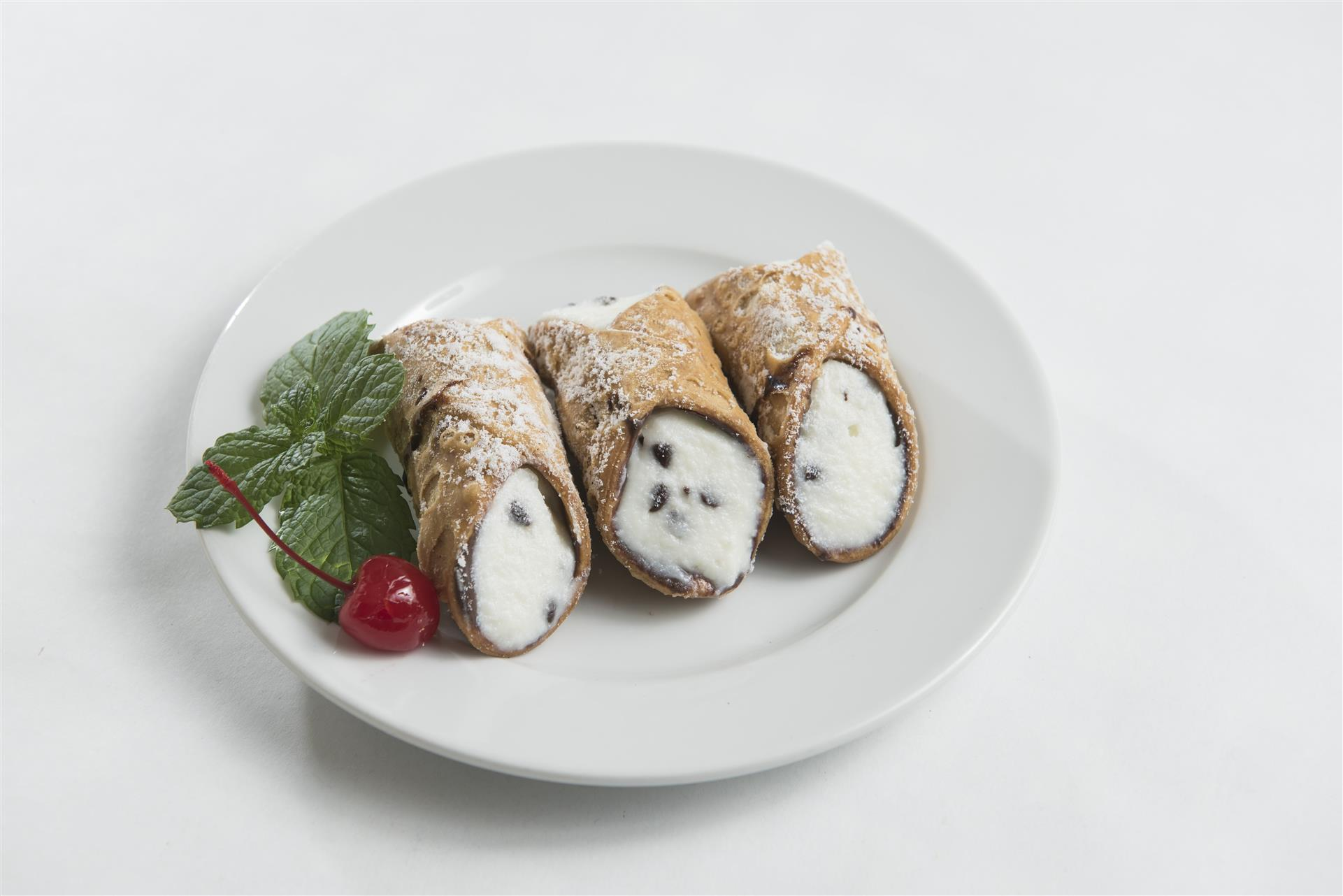 three cannoli's on a  plate