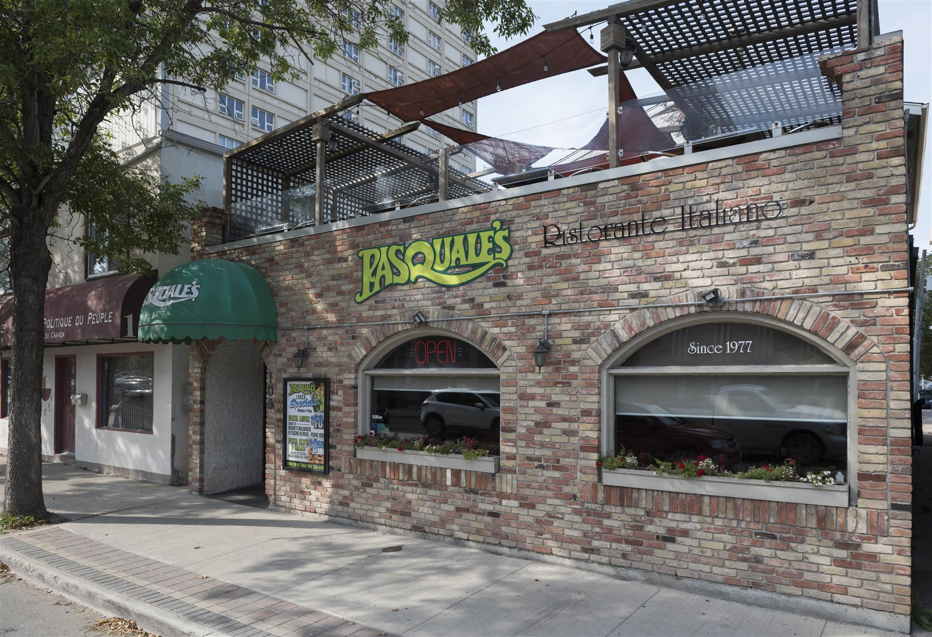 exterior side of pasquale's showcasing the second story eating area