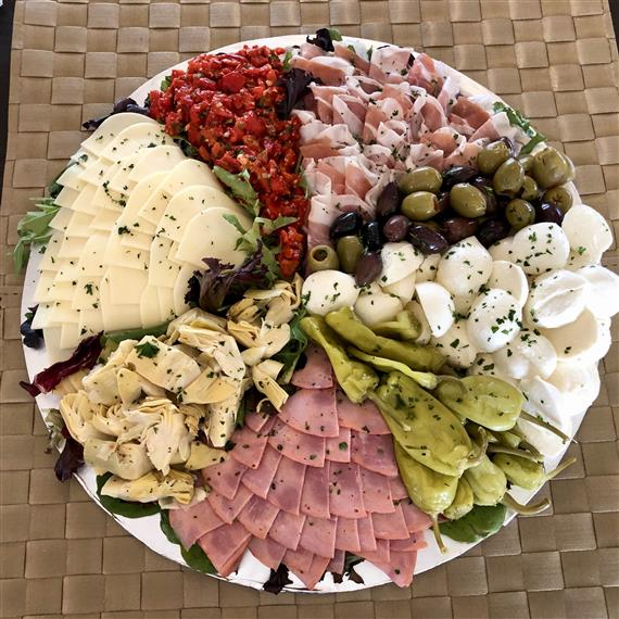 antipasto party platter with an assortment of meats and cheese