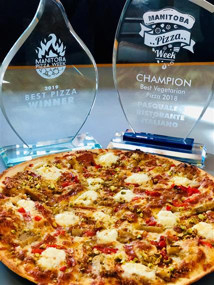 pizza next to two awards