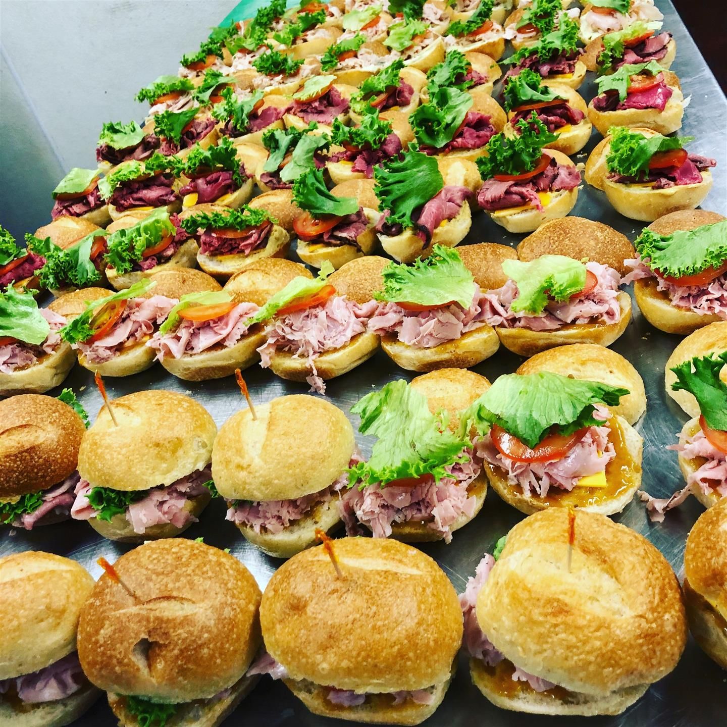 rows of sandwiches with meat and lettuce