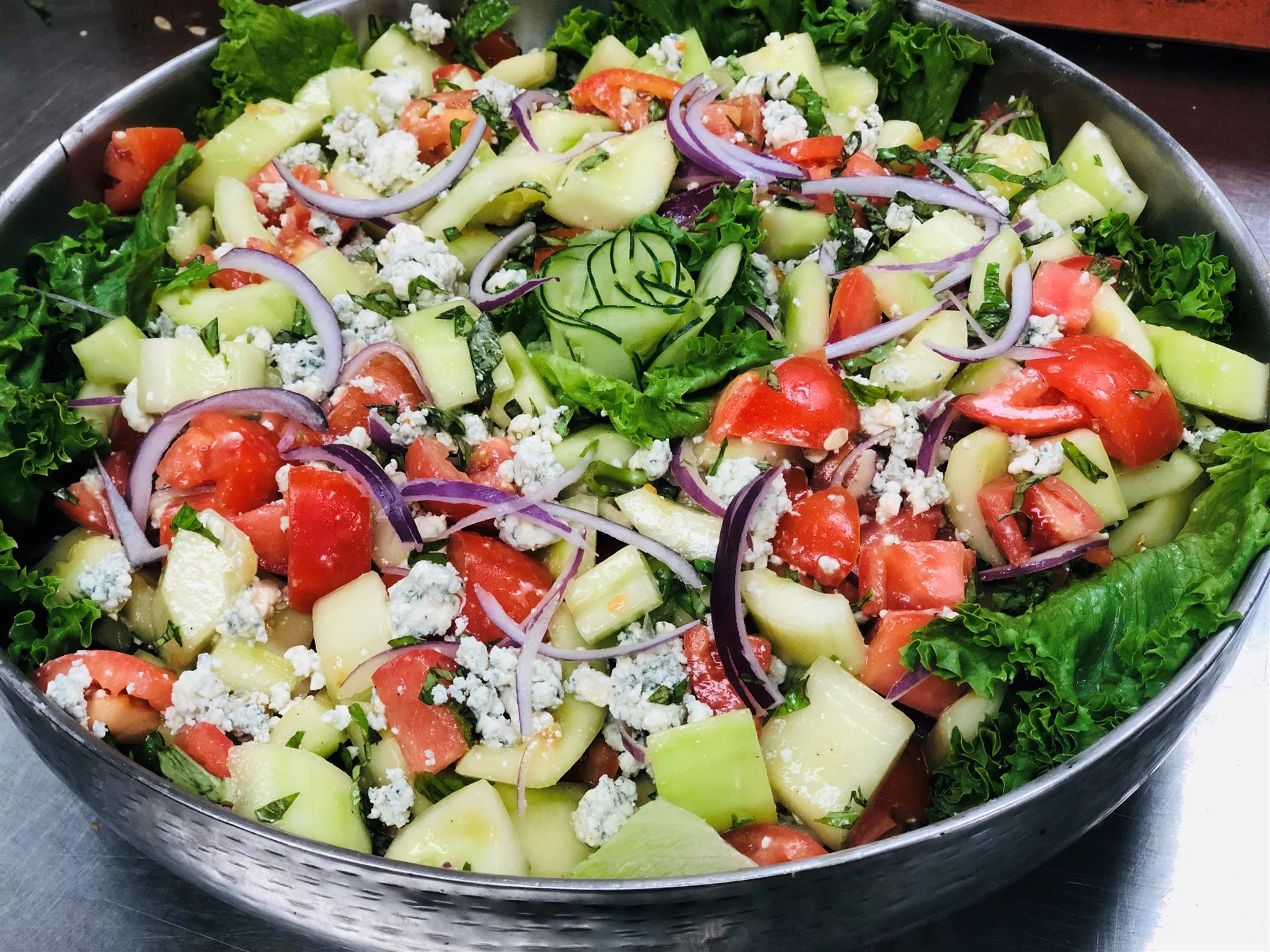 salad with cucumber, red onion, tomato and blue cheese