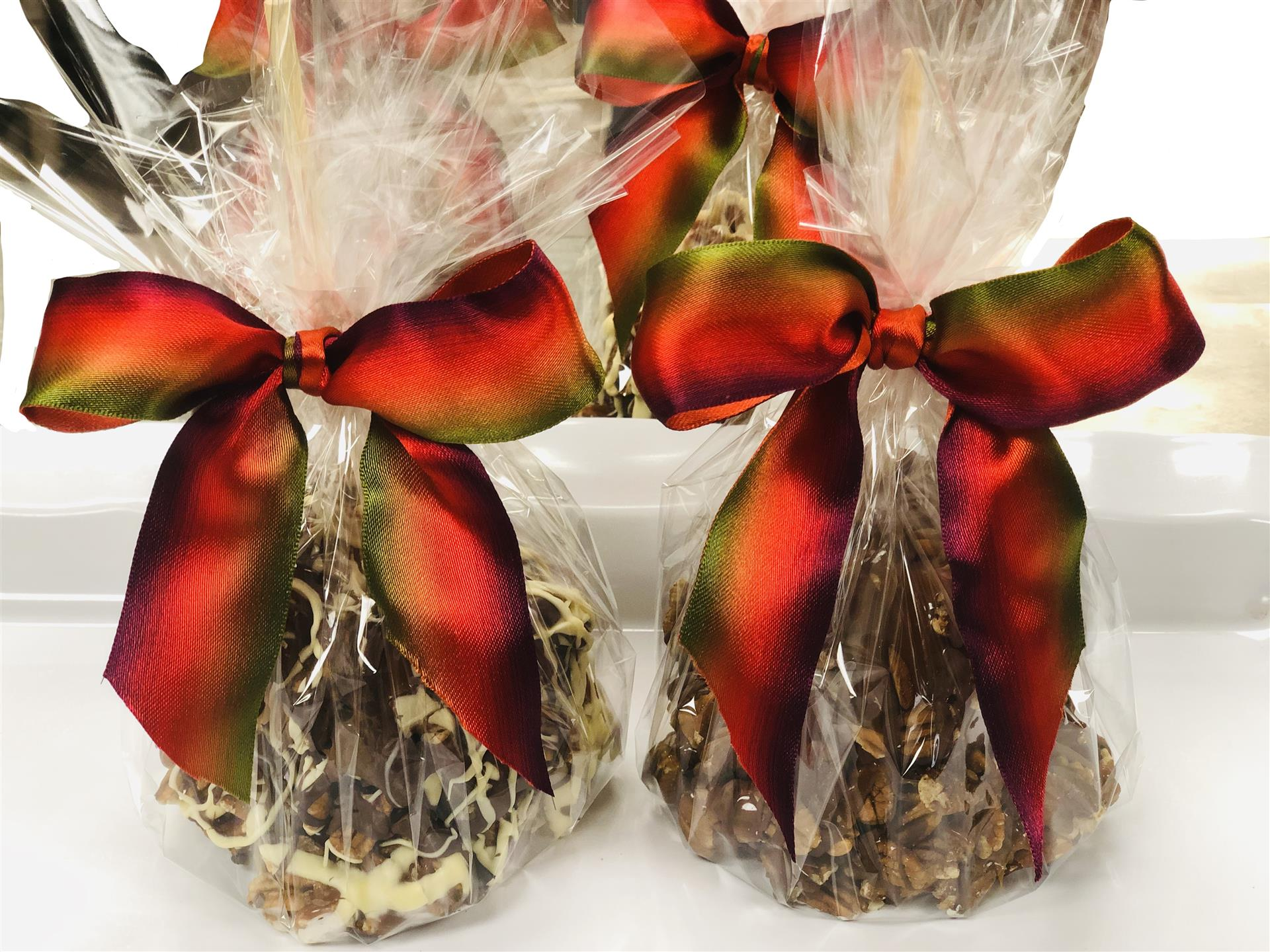 two caramel apples wrapped up
