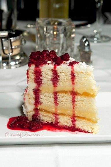 White cake topped with raspberries