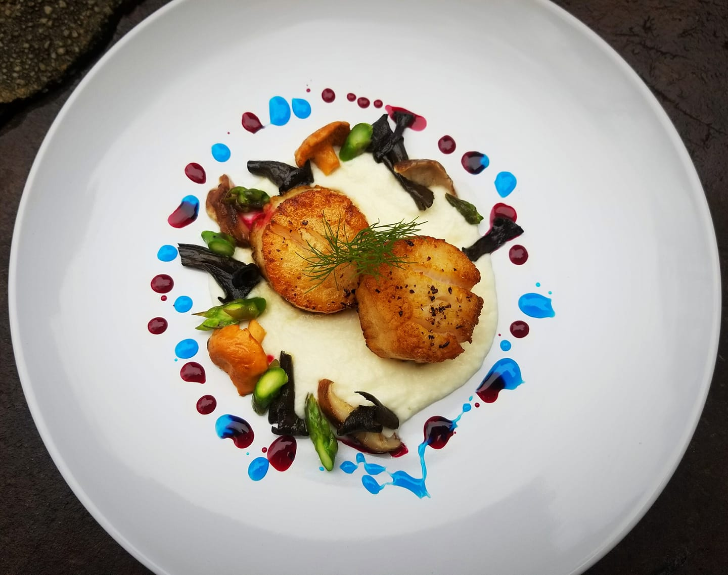 Pan seared scallops over polenta and assorted mixed veggies
