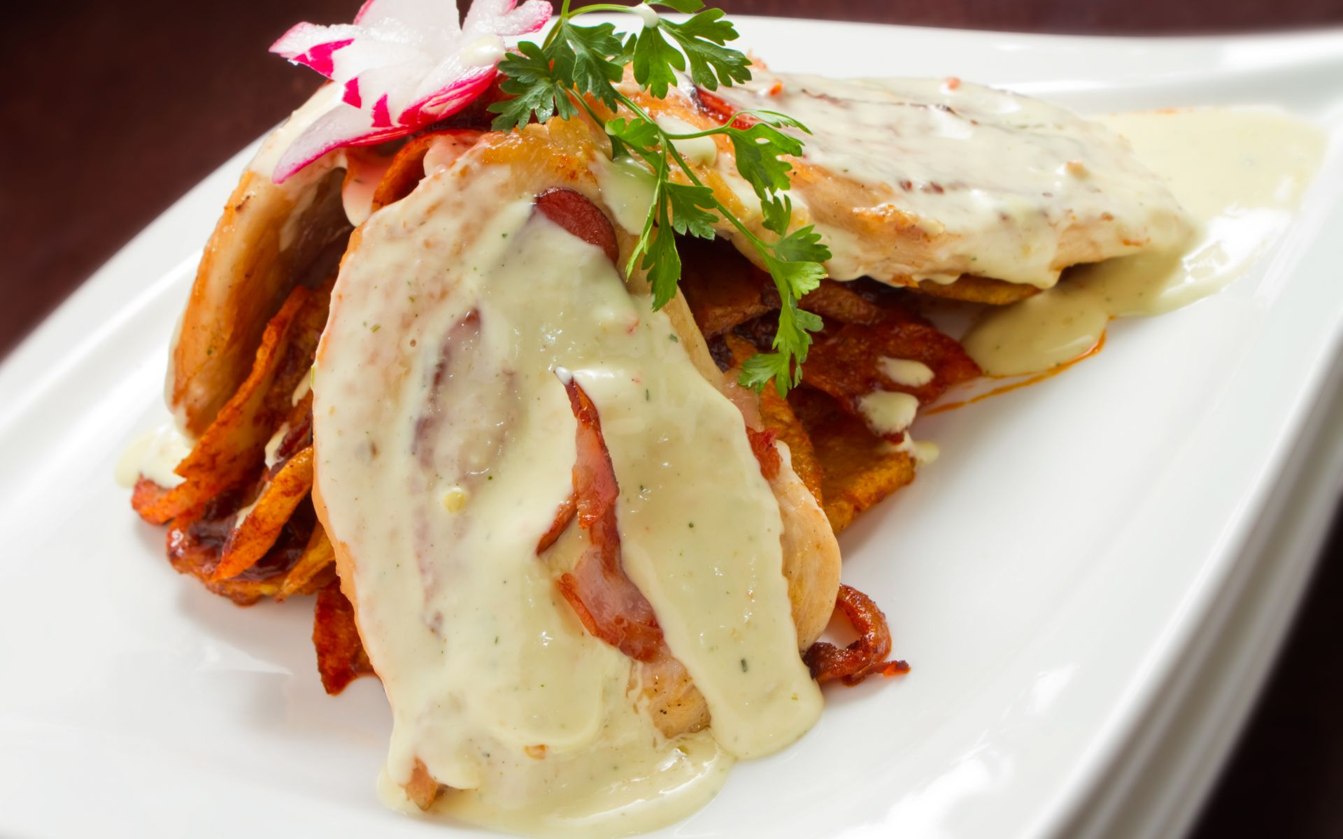 Chicken Saltimbocca with prosciutto and cheese sauce