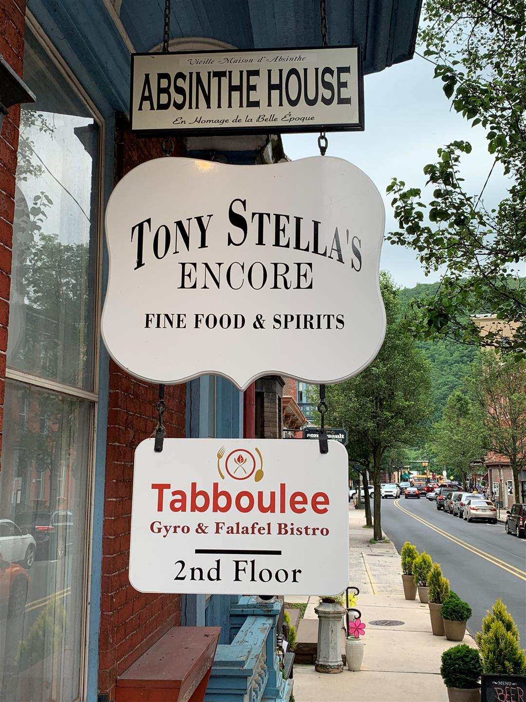 Absinthe House sign, Tony Stella's Encore Fine Food & Spirits sign, and Tabboulee Gyro Falafel Bistro 2nd floor sign