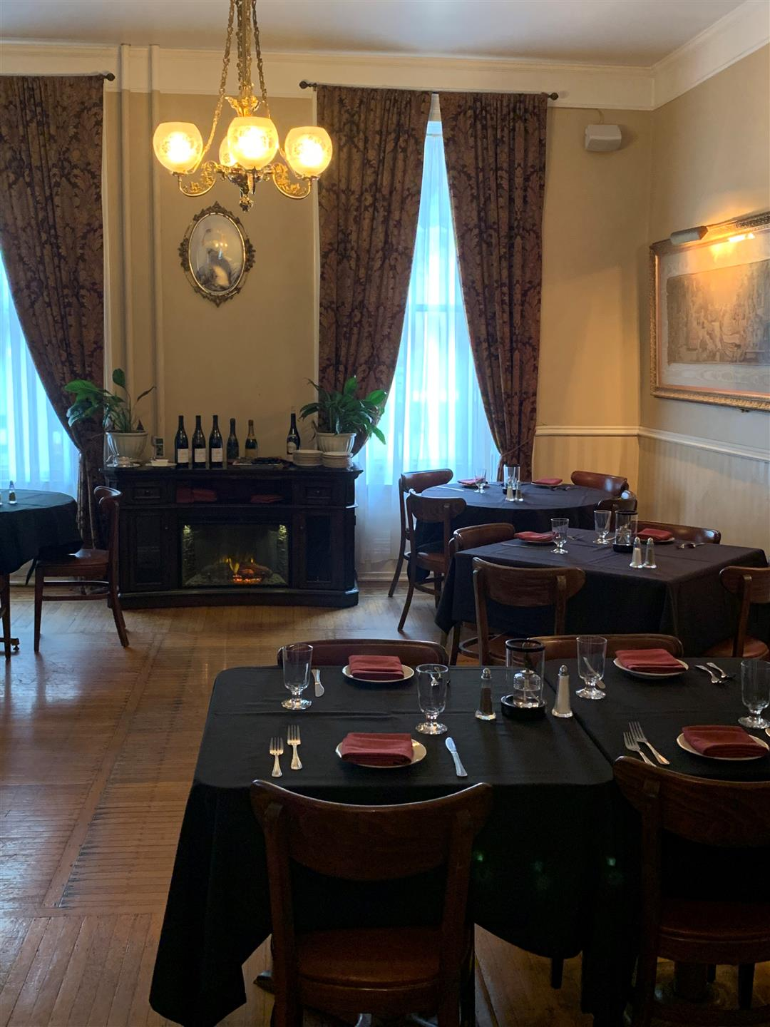 dining room filled with set tables and chairs
