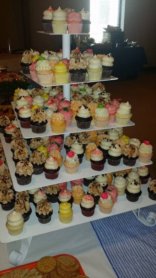 Multi-tier display with a selection of mini cupcakes