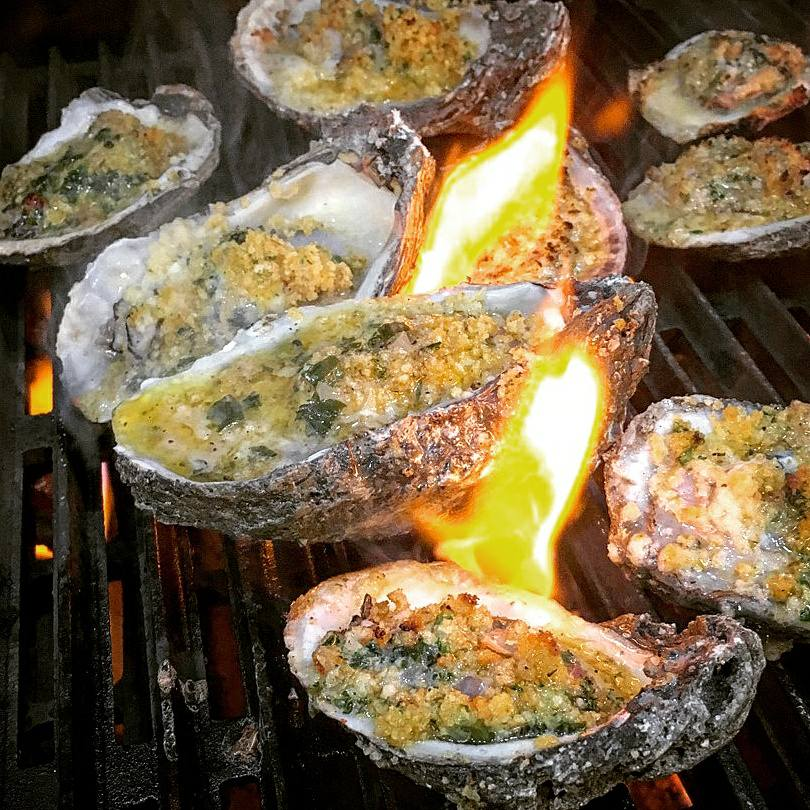 Char-grilled oysters on a flame grill
