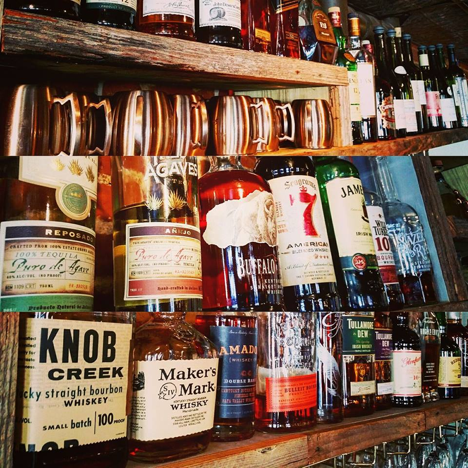 An assortment of whiskeys and liquors on a shelf