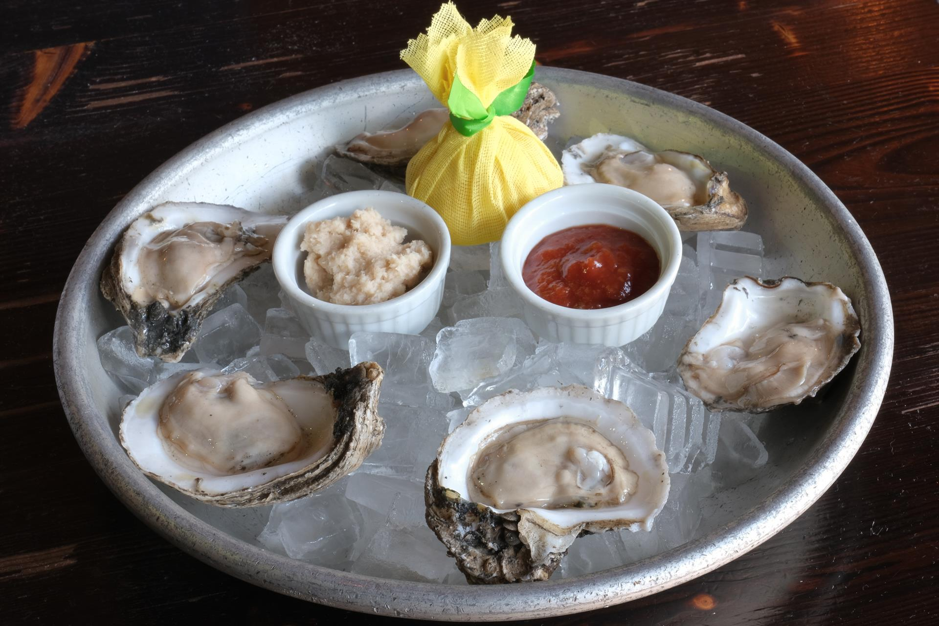 "Louisiana ""Select"" Raw Oysters. Served with horseradish & cocktail sauce"