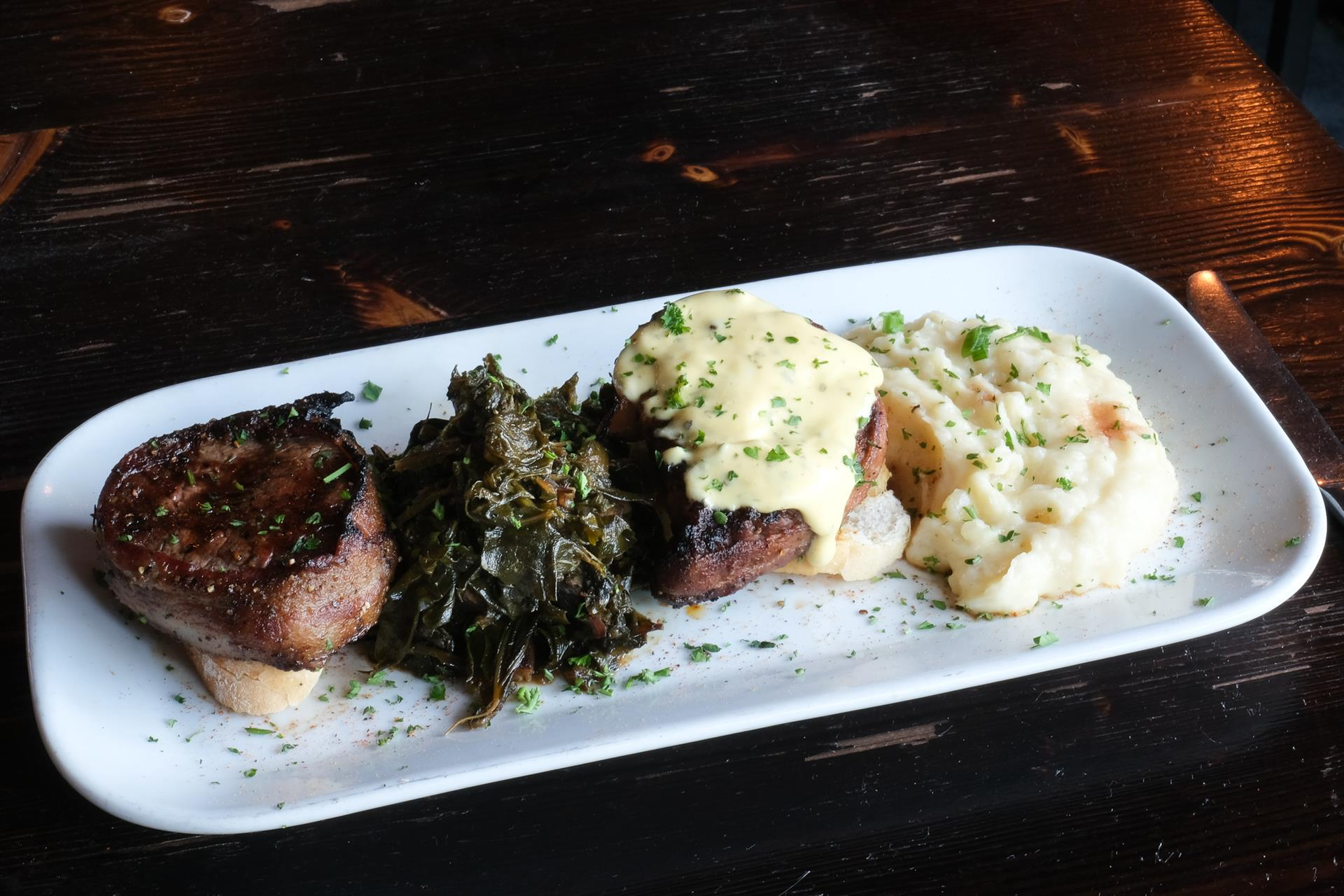 Cajun Prime Rib for 2. Not your typical prime rib. The 3-day process produces an amazing dining experience: blackened in a cast iron skillet, served with brown butter garlic sauce, a side of horseradish cream, mashed potatoes, and southern cooked greens