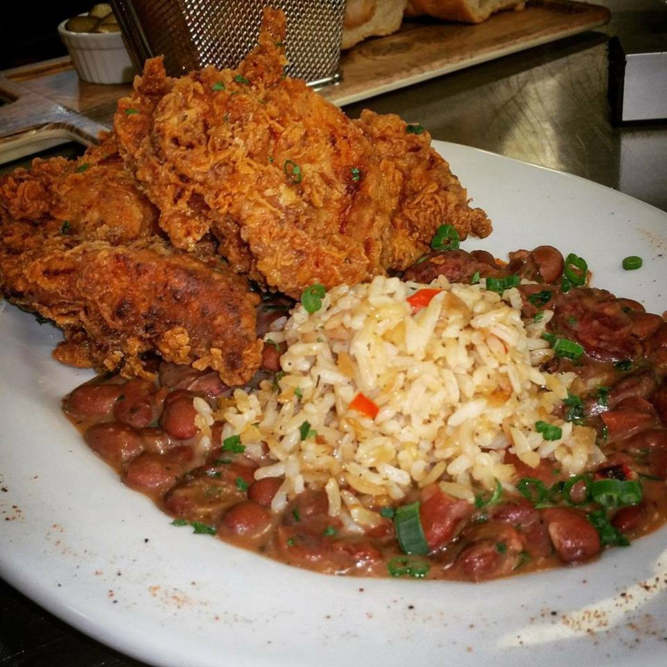 Southern fried chicken served with a side of red beans & rice with ham hock & Andouille