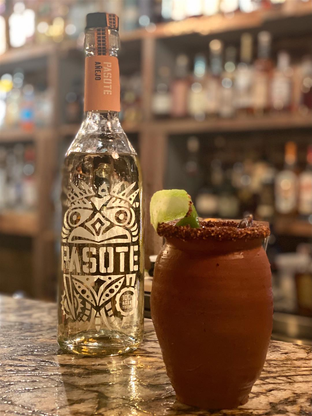 the Mayahuel (Aztec Goddess of Agave) Tequila, Hibiscus Water, Triple Sec, Lime Juice, Grapefruit Soda, Chamoy and Tajin Rim served in a hand made clay pot
