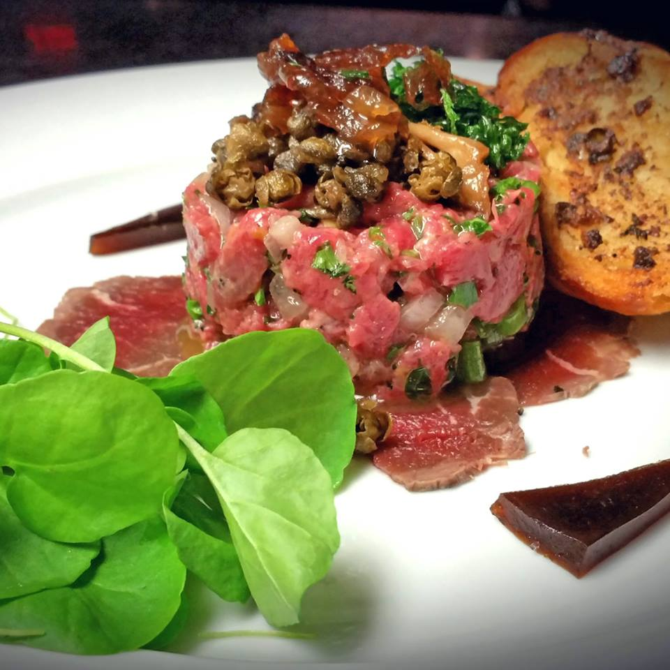 Filet Mignon Tartare & Carpaccio, Roasted marrow crostini, demi glace gelee, pickled mushrooms, confit shallots, crispy capers & parsley, hydroponic watercress
