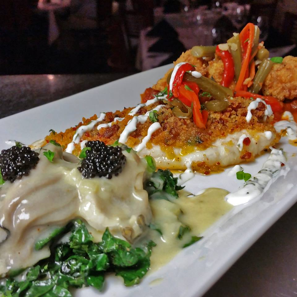 Herbsaint poached oysters topped with Cajun caviar with sauteed greens, chorizo-panko crusted flounder with lime-cilantro cream, and fried shrimp creole with smoked Andouille and pickled vegetables