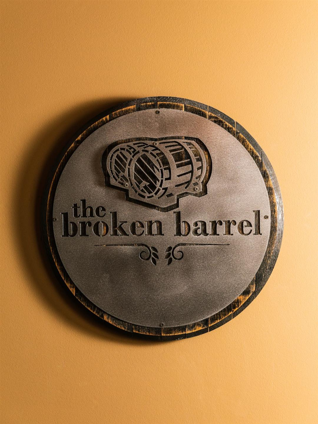 The Broken Barrel sign on a wall