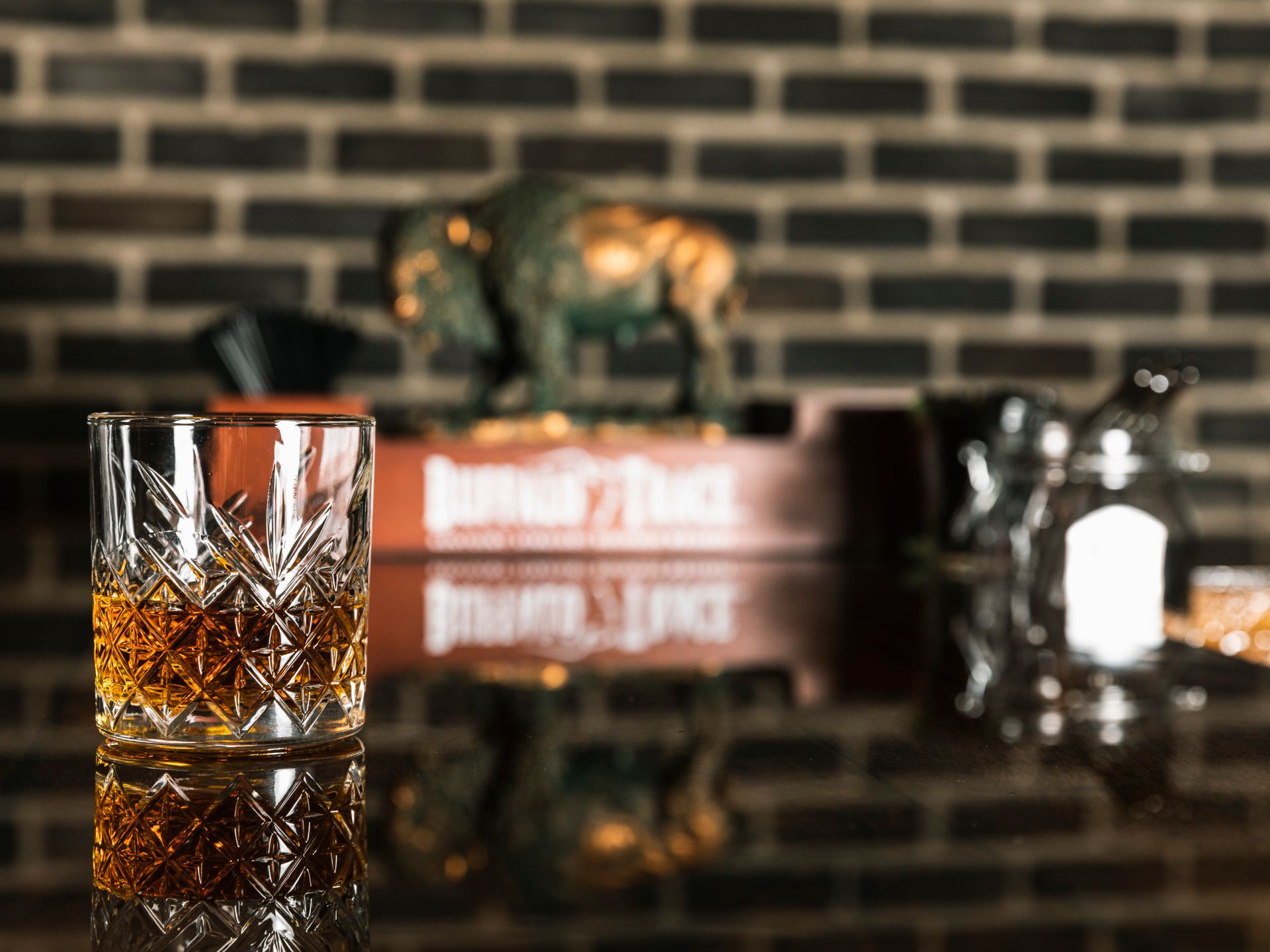 Whiskey in a glass on a bar-top