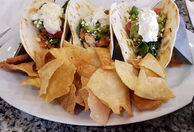 3 chicken tacos with jalapenos, tomatoes, lettuce sour cream and creme fresh with a side of chips and salsa