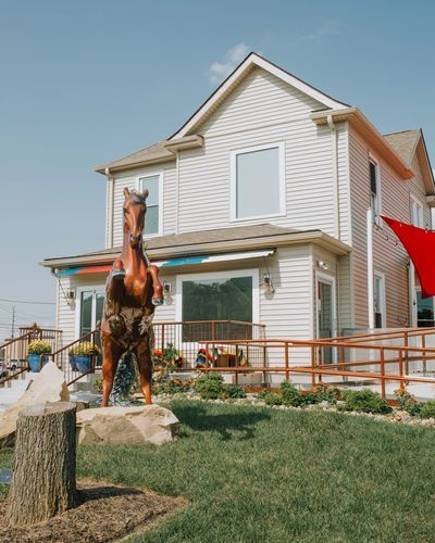 exterior view of building with horse statue on front lawn