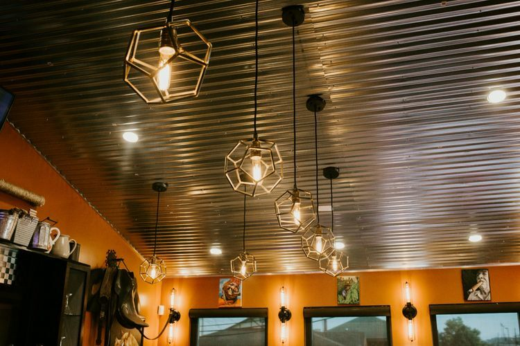 view of the ceiling with rustic restored metal light fixtures