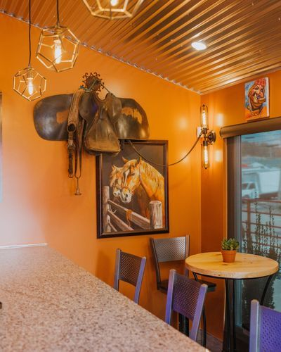 interior view of restaurant with funky decorations and a horse painting