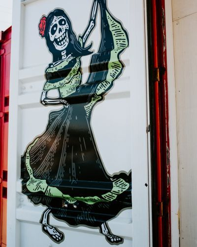 mural on door of a mariachi skeleton woman