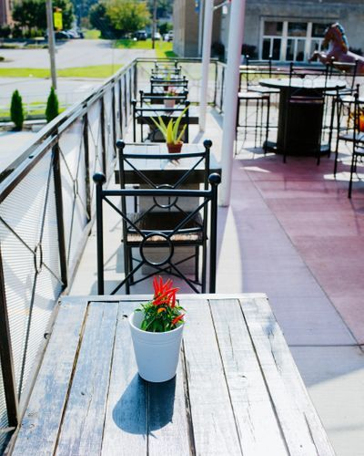 outdoor seating area with rustic furniture and flowers and succulents on the tables