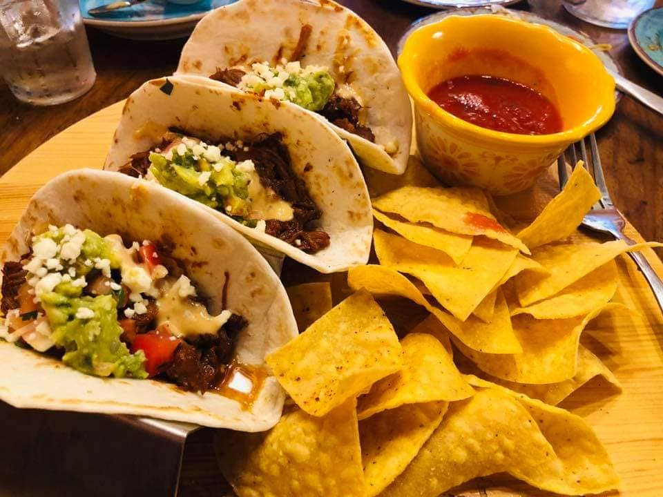 beef street tacos with guacamole, pico de gallo, cotija cheese, and chipotle sauce with chips and salsa