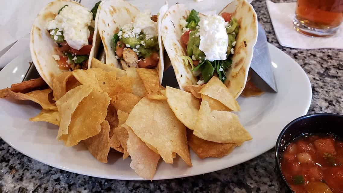 3 street style chicken tacos served with chips and salsa