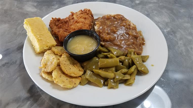 Hamburger Steak. Smothered with onions, Mashed Potatoes and Gravy, Fried Okra or Green Beans.