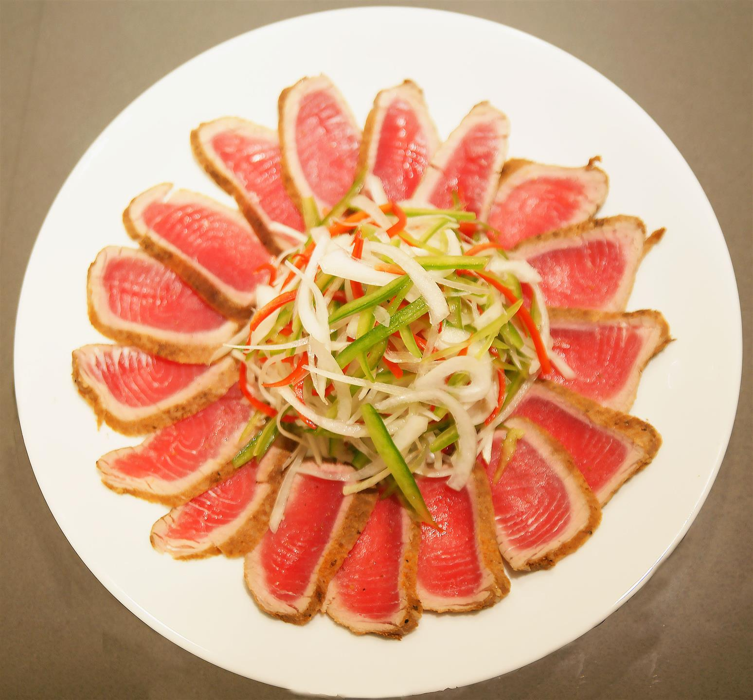 raw beef on a circular platter