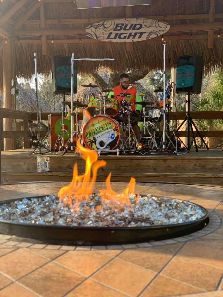 Fire pit in front of a drummer on stage