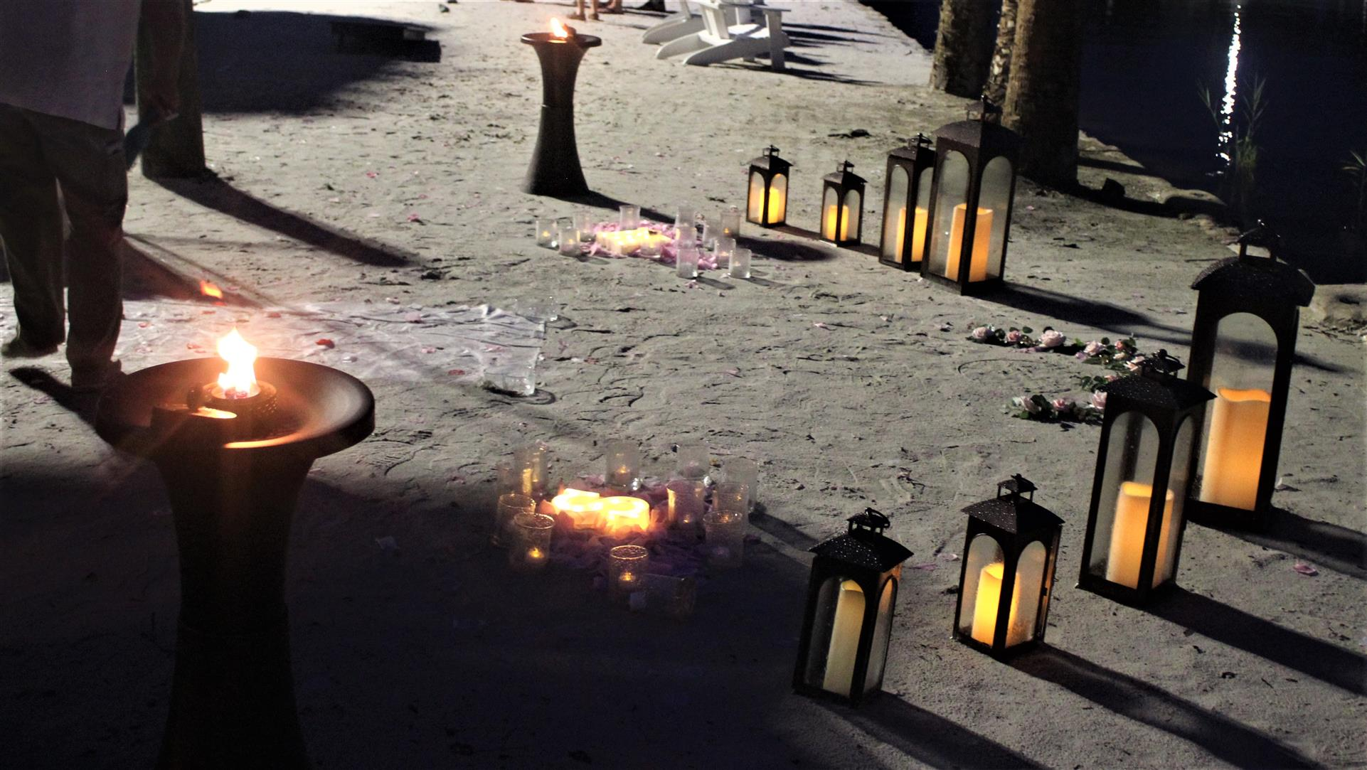 candles lit in a romantic setting in the sand at crumps landing