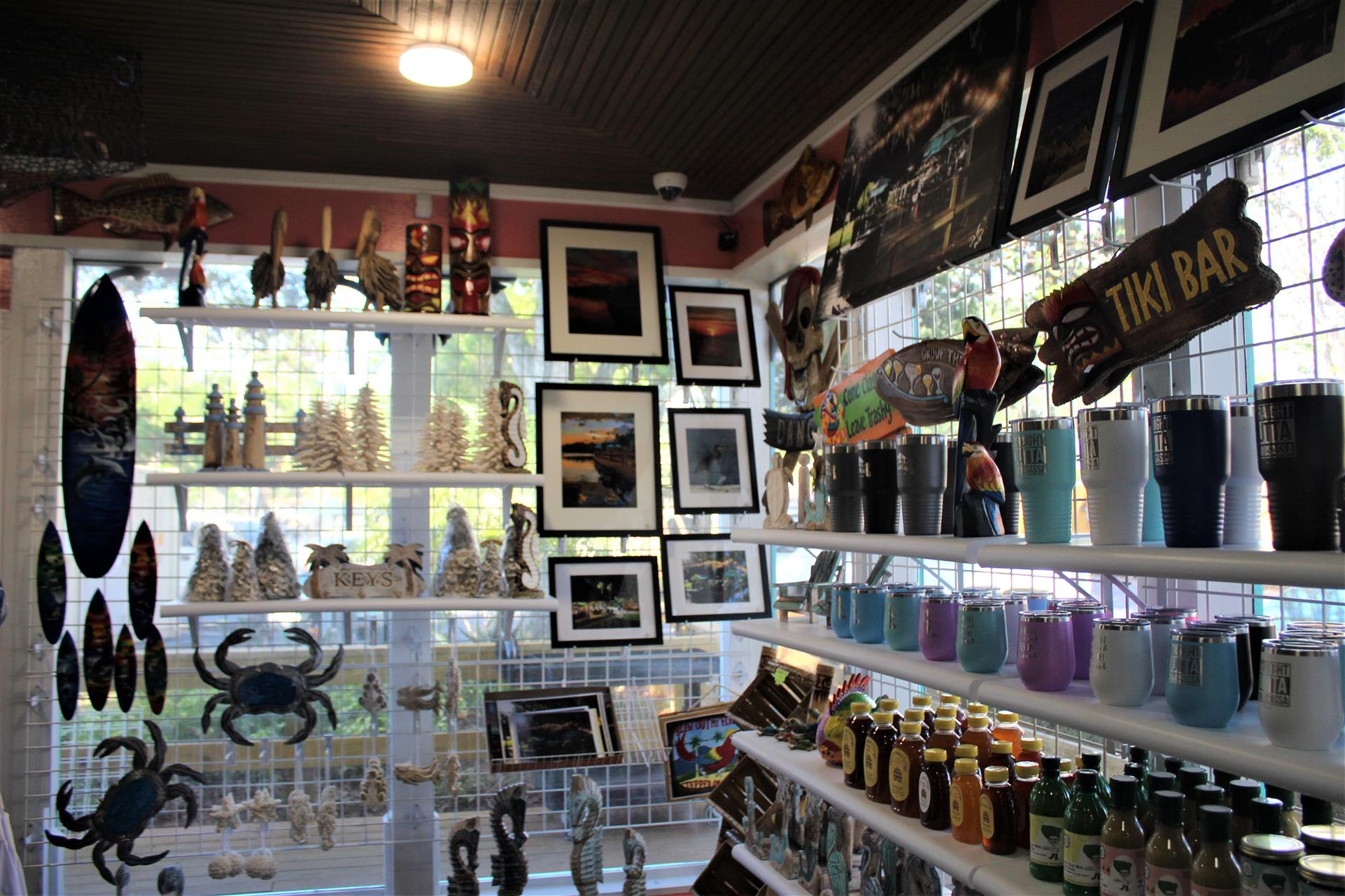 a gift shop that sells, signs, tumblers, pictures, signs, sauces, and wall decor.