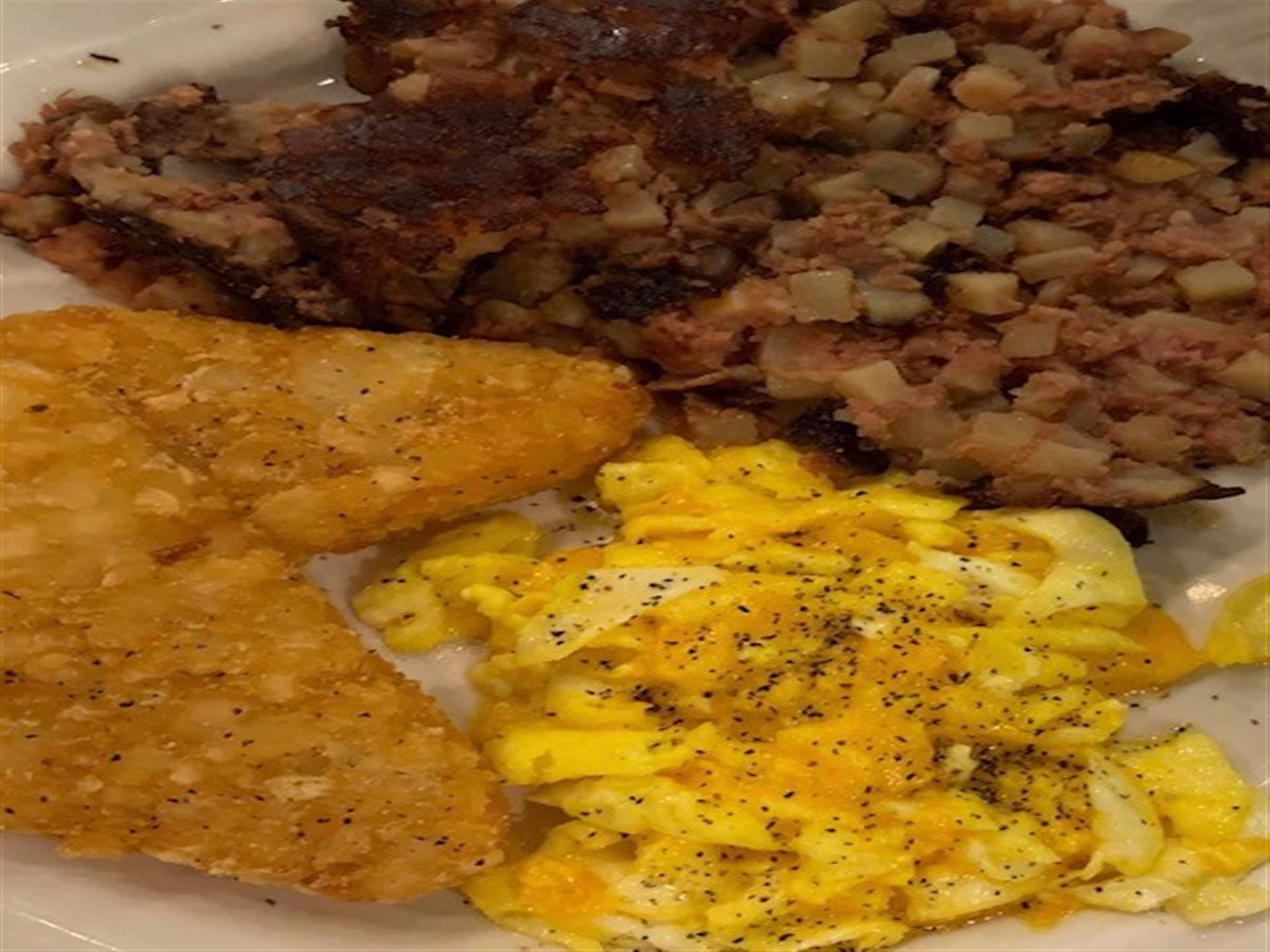 scrambled eggs, bacon and hash browns