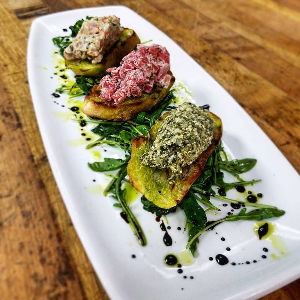 Bruschetta Trio, Beets and Cherve, Tomato Basil, and Spinach Artichoke Feta