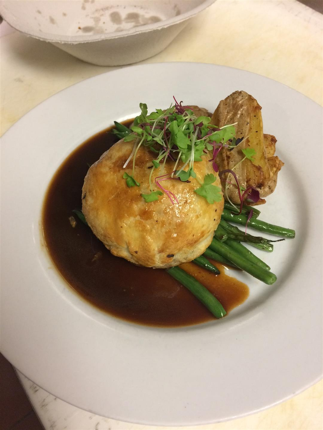 Roasted chicken over string beans and gravy