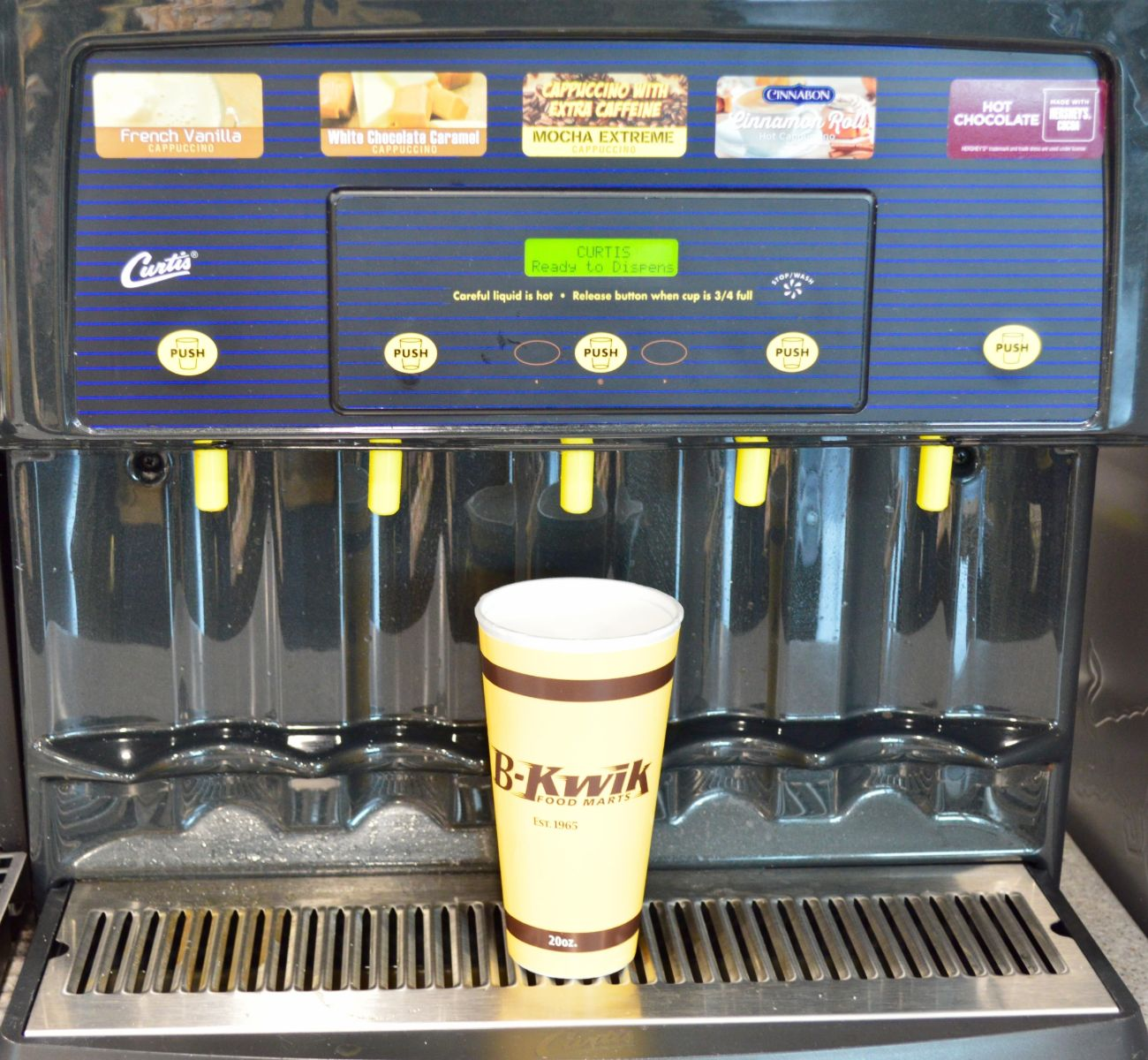 disposable cup under a hot chocolate and coffee machine