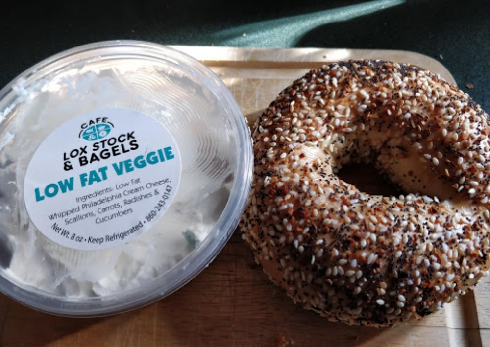 Bagel next to cream cheese