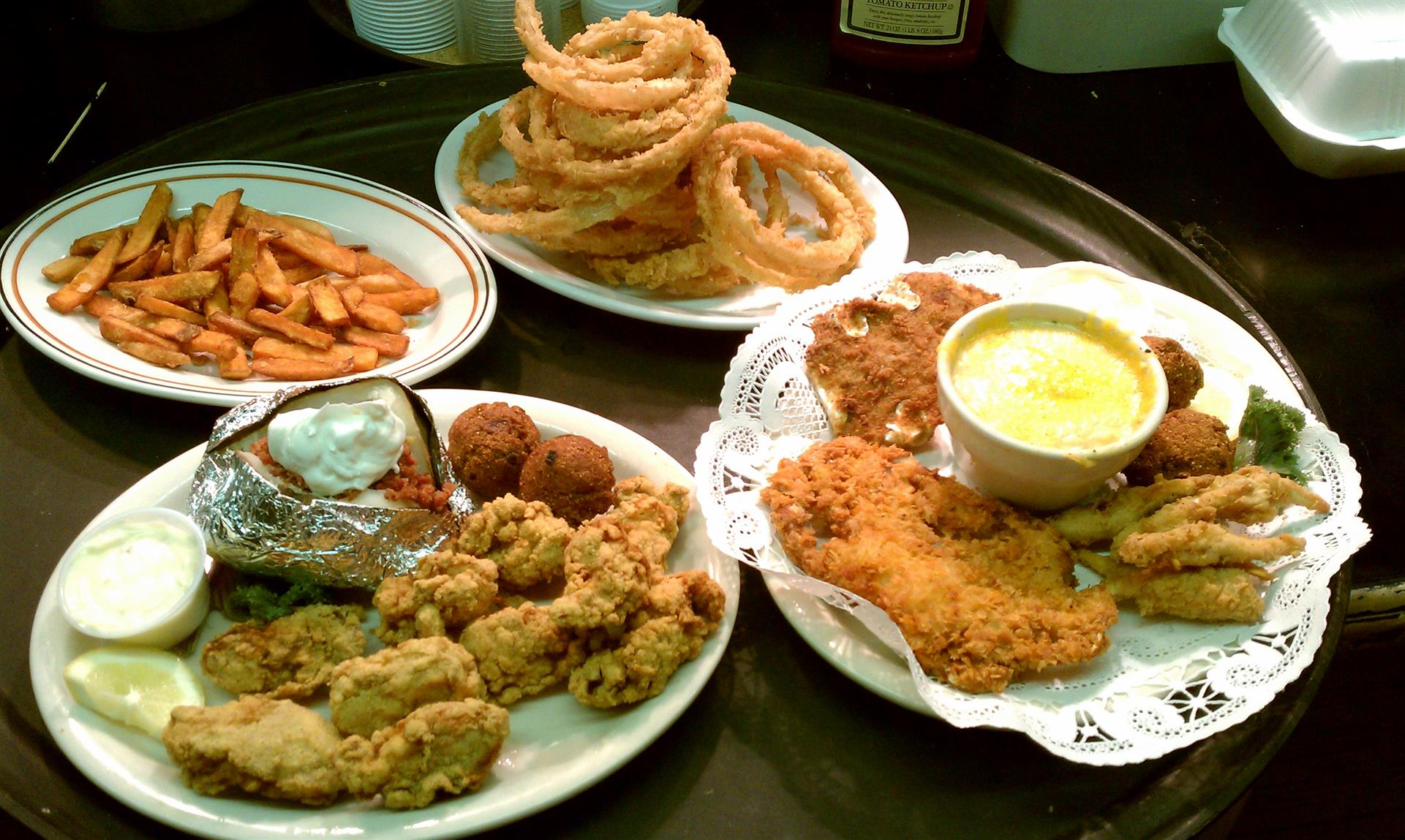 Fried Oysters Crab Platter with a side of onion rings