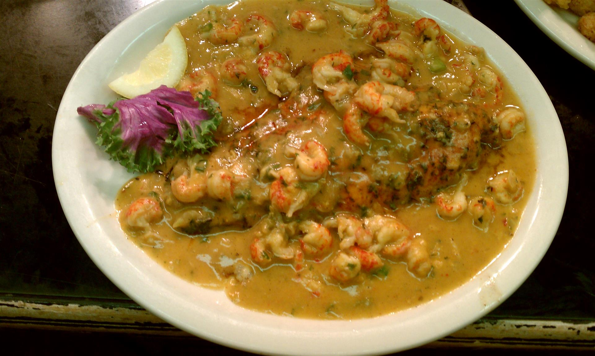 Cajun Catfish in sauce with vegetables