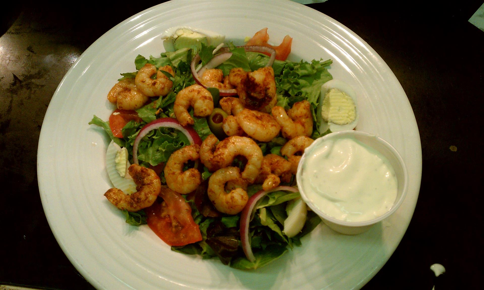 salad with cooked shrimp, onions, tomatoes and eggs.