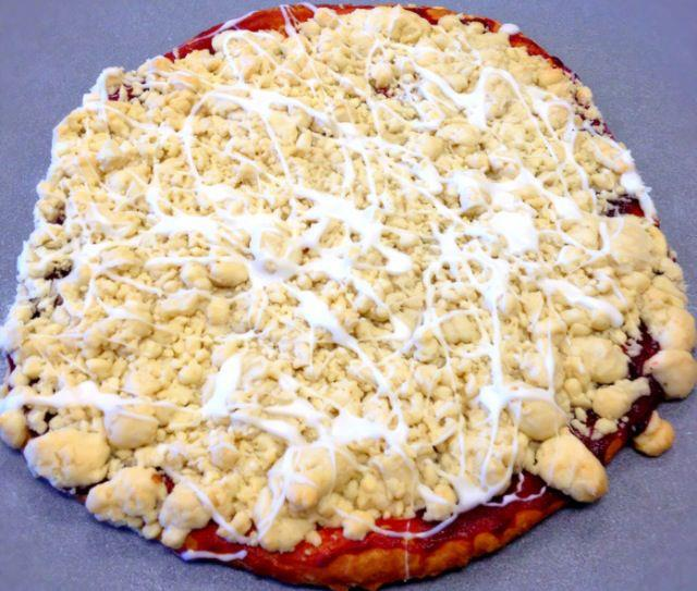 Raspberry pizza crumb displayed on a counter