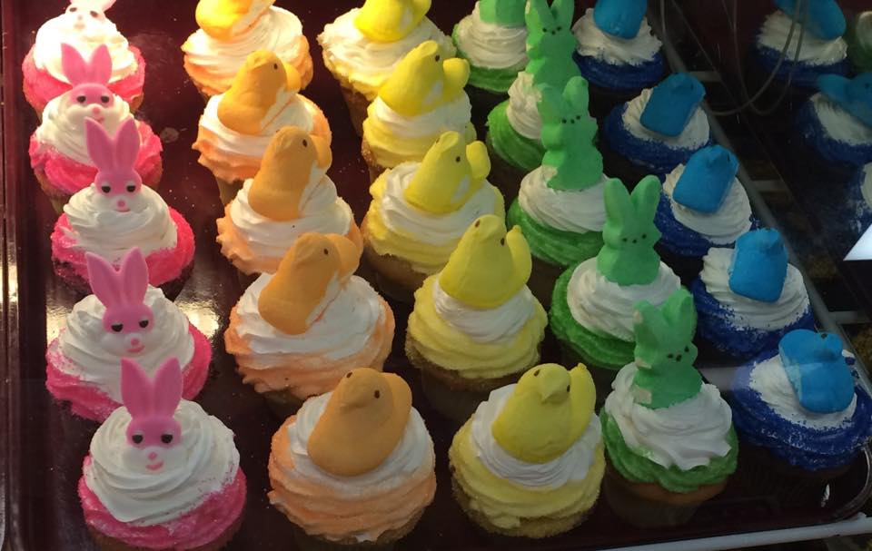 sheet tray of various peep themed cupcakes with a peep on top
