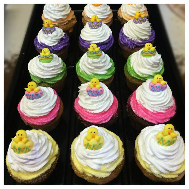 sheet tray of easter themed cupcakes