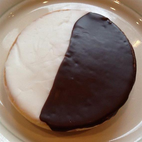 black and white cookie on a dish